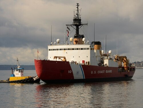 The crew of the Coast Guard Cutter Polar Star are finally approaching berths at Seattle Base on March 25, 2020. (PA3 Michael Clark / Coast Guard)
