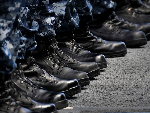 """Sailors stand at attention during an awards ceremony aboard the guided-missile cruiser Bunker Hill in 2010, during the mass introduction of new general-purpose safety boots to pair with the Type I """"Blueberry"""" Navy Working Uniform. (Navy)"""
