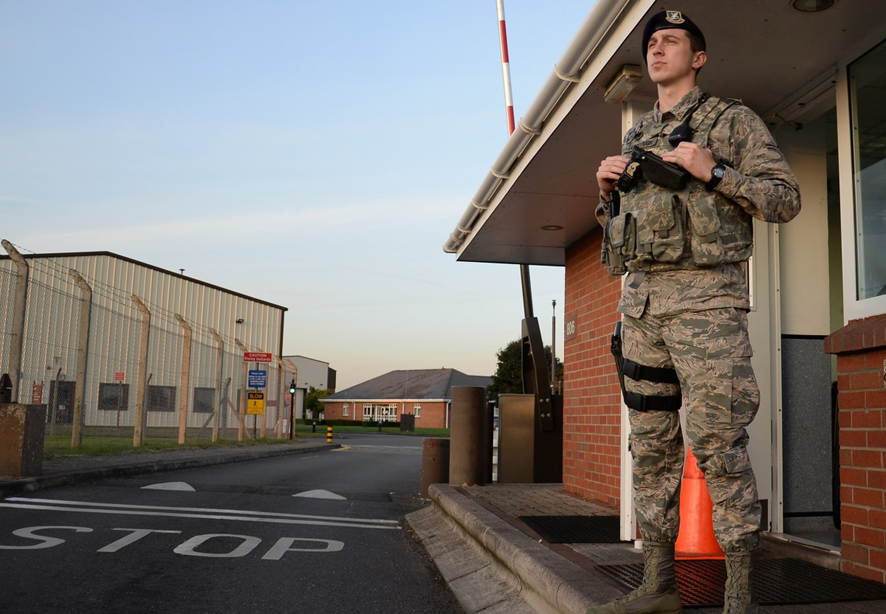 An airman with the 100th Security Forces Squadron keeps watch at the gate on RAF Mildenhall, England. Changes to base security have been made since an intruder managed to get on the Mildenhall flightline. (Gina Randall /Air Force)