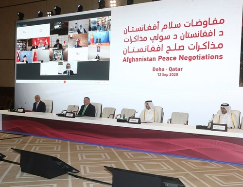 From left, U.S. Special Representative for Afghanistan Reconciliation Zalmay Khalilzad, U.S. Secretary of State Mike Pompeo, Qatar's Minister of Foreign Affairs Sheikh Mohamad Bin Abdel Rahman Al-Thani and Mutlaq bin Majid al-Qahtani, the special envoy of the Qatari Foreign Minister for Terrorism and Mediation in the Settlement of Disputes, attend the opening session of the peace talks between the Afghan government and the Taliban in Doha, Qatar, Saturday, Sept. 12, 2020. (Hussein Sayed/AP)