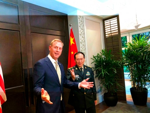 Acting U.S. Secretary of Defense Patrick Shanahan, left, meets with China's Minister of National Defense Wei Fenghe on the sidelines of the 18th International Institute for Strategic Studies Shangri-la Dialogue, an annual defense and security forum, in Singapore on Friday. (Lolita Baldor/AP)
