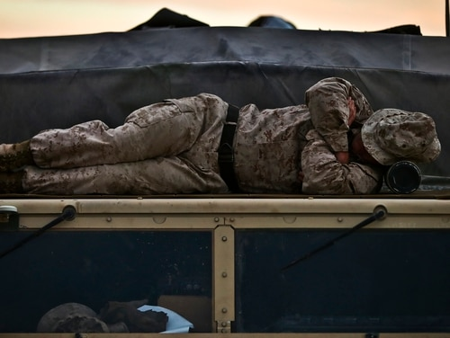 Sgt. Daniel Arivett, Headquarters and Service Company, 1st Battalion, 3rd Marines, sleeps on the roof of a vehicle during Integrated Training Exercise 2-17 at Marine Corps Air Ground Combat Center, Twentynine Palms, California, on Feb. 16, 2017. (Marine Corps)