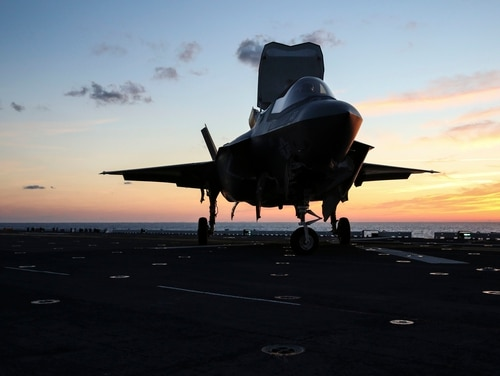 An F-35B Lightning II Joint Strike Fighter taxies to be refueled on the flight deck of amphibious assault ship Wasp (LHD-1) during night operations, a part of Operational Testing 1, May, 22, 2015. (Cpl. Anne K. Henry/Marine Corps)