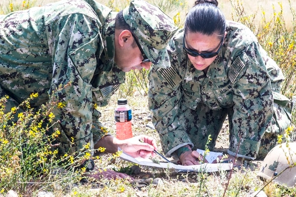 160415-N-DM338-104 MARINE AIR STATION MIRAMAR EAST, San Diego (April 14, 2016) Mass Communication Specialist 1st Class Jerry Jimenez and Mass Communication Specialist 1st Class Kleynia McKnight practices land navigation during a Navy Reserve Combat Camera Pacific annual field exercise. Combat Camera Pacific deploys trained documentation teams to hostile environments supporting the Navy's strategic, operational and tactical objectives. (U.S. Navy Combat Camera photo by Mass Communication Specialist 2nd Class Nicholas A. Groesch / Released).