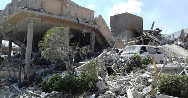 In this photo released by the Syrian official news agency SANA, shows the damage of the Syrian Scientific Research Center which was attacked by U.S., British and French military strikes to punish President Bashar Assad for suspected chemical attack against civilians, in Barzeh, near Damascus, Syria, Saturday, April 14, 2018. (SANA via AP)