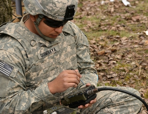 A paratrooper uses a Defense Advanced GPS Receiver during a combined-arms live-fire exercise at Grafenwoehr, Germany. The U.S. Army is developing a vision-aided system and other means to guide soldiers when GPS is imperiled. (Spc. Markus Rauchenberger/U.S. Army)