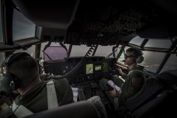 Maj. Jason Fox, left, an 18th Flight Test Squadron pilot, and Maj. Brian Pesta, a pilot with 1st Special Operations Group Detachment 2, look out the window during the delivery flight of Air Force Special Operations Command's first AC-130J Ghostrider to the 1st Special Operations Wing at Hurlburt Field, Fla., in July 2015. (Senior Airman Christopher Callaway/Air Force)
