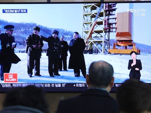 A man watches a TV screen showing a file image of the North Korean leader Kim Jong Un at his county long-range rocket launch site during a news program at the Seoul Railway Station in Seoul, South Korea, Monday, Dec. 9, 2019. (Ahn Young-joon/AP)
