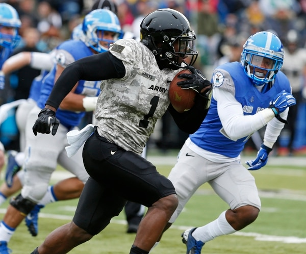 Army fullback Raymond Maples (1) runs against the Air Force defense during the first half of an NCAA college football game on Saturday, Nov. 1, 2014, in West Point, N.Y. Air Force won 23-6. (AP Photo/Mike Groll)