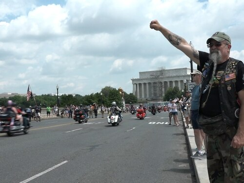 Air Force veteran Ray Weaver of Lancaster, Pa., salutes members of the annual Rolling Thunder ride in Washington, D.C. on May 27, 2018. Group organizers announced this week the 2019 event will be the last large-scale national ride because of growing costs. (Ben Murray/Military Times)