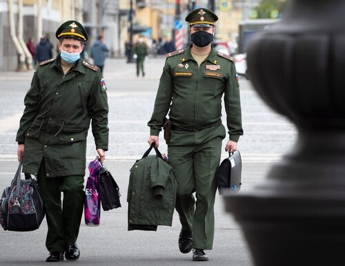 Russian army officers wearing face masks to protect against coronavirus walk in St. Petersburg, Russia, Tuesday, May 19, 2020. (Dmitri Lovetsky/AP)