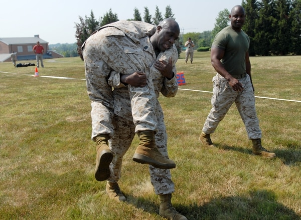 Sgt. Maj. Roanld Green (center) at the Marine Corps Training and Education Command unveilling of their new Combat Fitness Test at Henderson Hall in Arlington, Va., August 18, 2008. The test involves a variety of excercises meant to simulate actions in combat - such as crawling, running, carrying a soldier on your shoulders, lifting and running with ammunition boxes, throwing a grenade, pushups, etc.