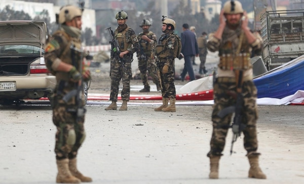 Security forces inspect the site of a suicide attack in Kabul, Afghanistan, Friday, March 2, 2018. A large explosion in the eastern part of the Afghan capital on Friday morning killed at least one and wounding others officials said. (Massoud Hossaini/AP)