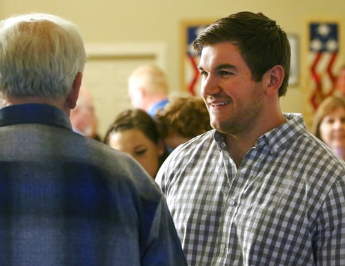Alek Skarlatos, right, speaks with former Douglas County Commissioner Mike Winters at the Douglas County Republican Party headquarters in Roseburg, Ore., May 15, 2018. (Michael Sullivan/The News-Review via AP)