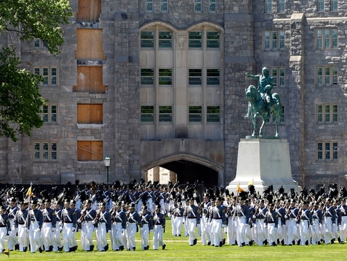 In this May 22, 2019, file photo, members of the senior class march past a statue of George Washington during Parade Day at the U.S. Military Academy in West Point, N.Y. (Mark Lennihan/AP)