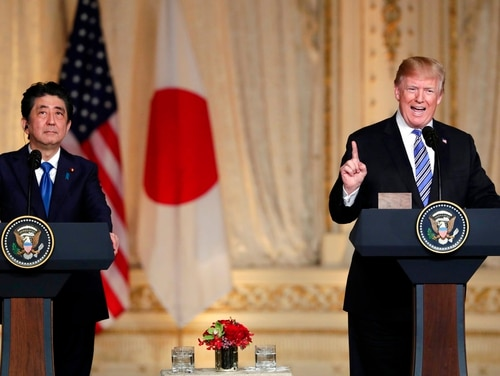 Japanese Prime Minister Shinzo Abe, left, listens as President Donald Trump speaks during a news conference at Trump's private Mar-a-Lago club on April 18, 2018, in Palm Beach, Fla. (Lynne Sladky/AP)