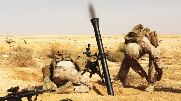 U.S. Marines with Weapons Company, 1st Battalion, 7th Marine Regiment, Special Purpose Marine Air-Ground Task Force--Crisis Response--Central Command, fire a M252A2 81 mm mortar system during a live-fire training mission at Al Asad Air Base, Iraq, Oct. 24, 2015. The training allowed the Marines to maintain proficiency while also expanding their knowledge on the new weapons system. These Marines are supporting Combined Joint Task Force – Operation Inherent Resolve, which has 65 coalition partners who are committed to the goals of eliminating the threat posed by the Islamic State of Iraq and the Levant. (U.S. Marine Corps photo by Sgt. Owen Kimbrel/Released)