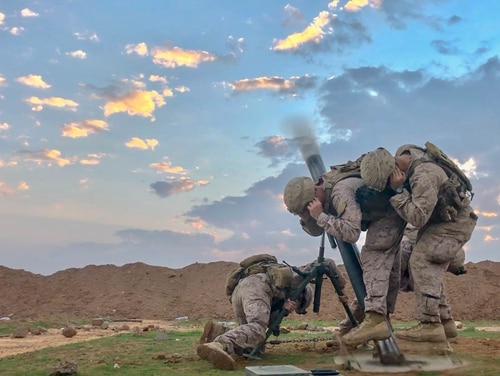 U.S. Marines fire an M120 Mortar during a mission in support of Inherent Resolve, the coalition to eliminate ISIS. (Sgt. Matthew Crane/Army)