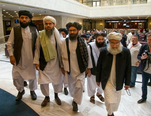 In this file photo taken on May 28, 2019, Mullah Abdul Ghani Baradar, the Taliban group's top political leader, third from left, arrives with other members of the Taliban delegation for talks in Moscow. (Alexander Zemlianichenko/AP)