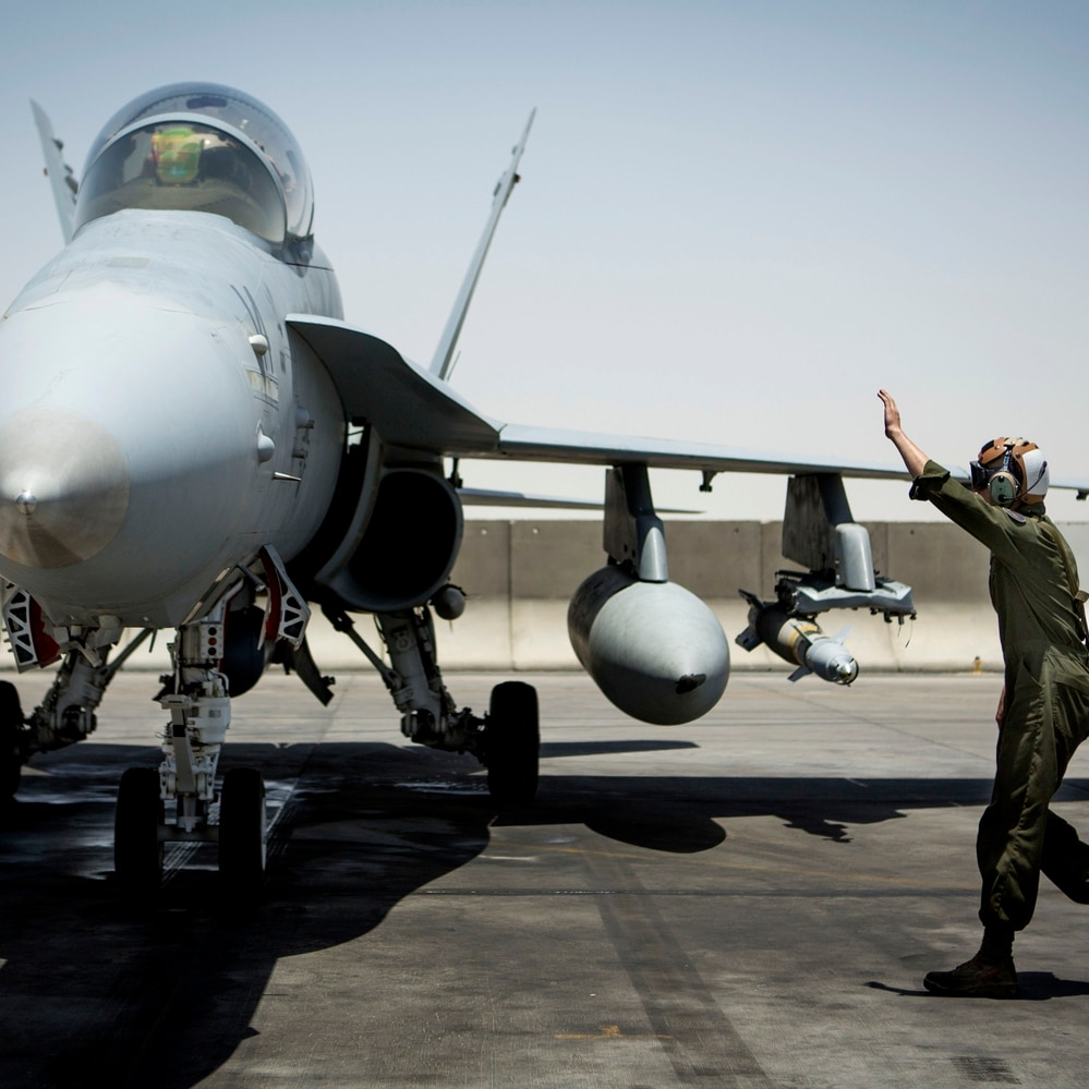 A U.S. Marine with Marine All-Weather Fighter Attack Squadron 533, Special Purpose Marine Air Ground Task Force - Crisis Response - Central Command 16.2, directs an F/A-18D Hornet returning to an undisclosed location in Southwest Asia, June 9, 2016. (Sgt. Donald Holbert/Marine Corps)