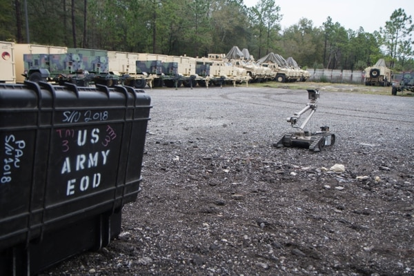 Soldiers of the 221st Explosive Ordnance Disposal Company perform preventative maintenance checks and services on the PacBot, used for examining explosive devices. Endeavor supplied PacBots to the service as well as a few other small unmanned ground vehicles. (Pvt. Kourtney Grimes/U.S. Army)