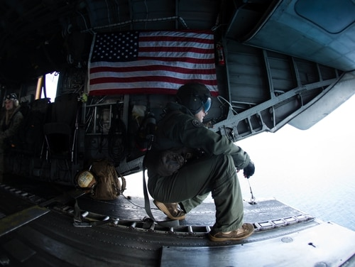 Marine Corps Sgt. Andrew J. Mocarski with Marine Medium Tiltrotor Squadron 162 (Reinforced), 26th Marine Expeditionary Unit, looks out the back of a CH-53E Super Stallion to deliver essential emergency care items to St. Thomas, U.S. Virgin Islands, Sept. 10. (Lance Cpl. Alexis C. Schneider/Marine Corps)