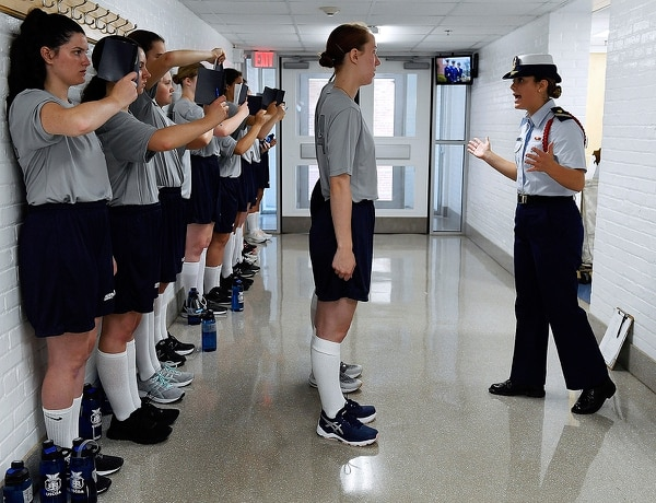 On July 1, female swabs learn the positions of attention and parade rest while their male classmates get haircuts during the first day of a seven-week orientation for the Class of 2023 at the U.S. Coast Guard Academy in New London, Conn. (Sean D. Elliot/The Day via AP)