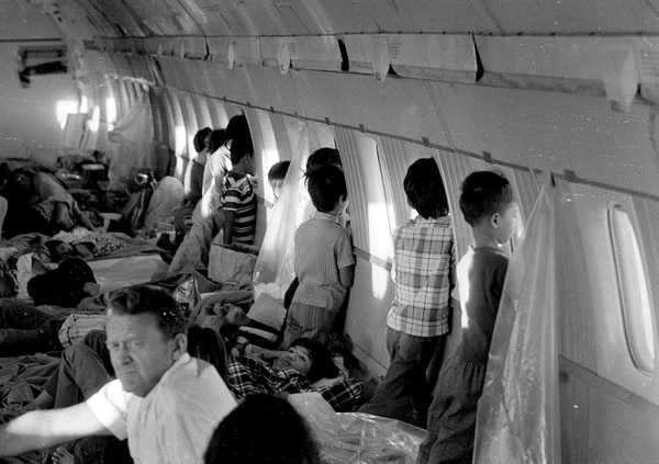 ADVANCE FOR USE SATURDAY, APRIL 25, 2015, AND THEREAFTER- FILE - In this April 1975 file photo, orphans aboard the first