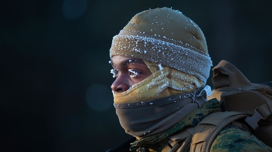 U.S. Marine Corps Lance Cpl. Kwan Walker, a networking administrator assigned to Marine Wing Communication Squadron 28, braces in the cold during a conditioning hike during exercise Ullr Shield at Fort McCoy, Wisconsin, Jan. 13, 2018. U.S. Marine Corps photo by Lance Cpl. Cody Rowe