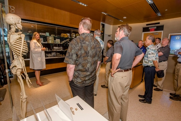 Dr. Debra P. Zinni, laboratory manager at Defense POW/MIA Accounting Agency, briefs officials on the process of identifying remains of servicemembers during a tour of DPAA facilities at Joint Base Pearl Harbor-Hickam in Hawaii on April 23, 2018. (Sgt. Kelly L. Street/Marine Corps)