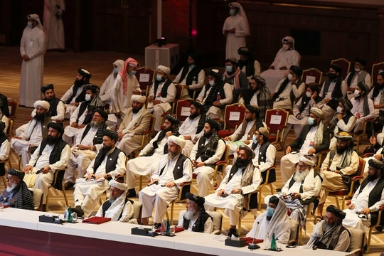 Members of the Taliban delegation attend the opening session of the peace talks between the Afghan government and the Taliban in the Qatari capital Doha on Sept. 12, 2020. (Karim Jaafar/AFP via Getty Images)