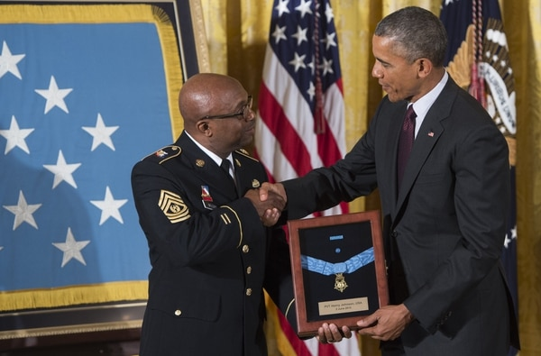 US President Barack Obama presents the Medal of Honor to Command Sergeant Major Louis Wilson of the New York National Guard, who is accepting on behalf of the late Army Private Henry Johnson, for actions while serving in France during World War I, during a ceremony in the East Room of the White House in Washington, DC, June 2, 2015. Obama also awarded a Medal of Honor to the late Army Sergeant William Shemin for his actions, also during World War I. AFP PHOTO / SAUL LOEBSAUL LOEB/AFP/Getty Images