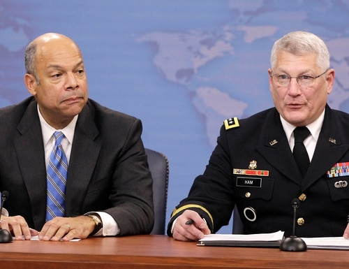 Pentagon General Counsel Jeh Johnson, left, and Army Gen. Carter Ham speak to reporters on gays in the military, Nov. 30, 2010, at the Pentagon. (Charles Dharapak/AP)