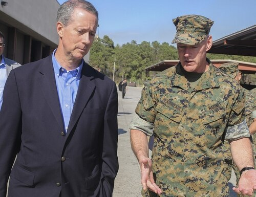 House Armed Services Committee ranking member Rep. Mac Thornberry, R-Texas, speaks with Marine Corps Maj. Gen. Brian Beaudreault at Marine Corps Base Camp Lejeune, N.C., in 2016. (Cpl. Lucas Hopkins/Marine Corps)