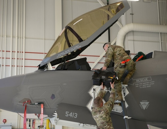 Staff Sgt. Victor Benitez and Tech. Sgt. Rylee James install the new Arctic survival seat kit for the F-35A on Eielson Air Force Base, Alaska, Sept. 28, 2020. (Senior Airman Beaux Hebert/Air Force)