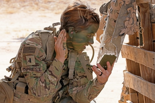 1st Lt. Shelby DePriest, an infantry soldier with 3rd Armored Brigade Combat Team, 4th Infantry Division, applies camouflage face paint during patrol lane testing for the Expert Infantryman Badge at Camp Buehring, Kuwait on Friday, May 31, 2019. (Sgt. Liane Hatch/Army)