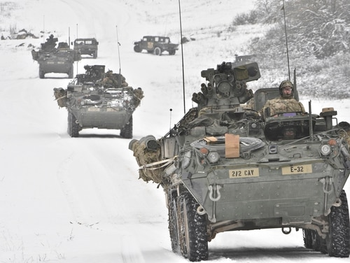 Troopers assigned to 2nd Cavalry Regiment convoy with their Stryker combat vehicles during training at the Joint Multinational Readiness Center in Hohenfels, Germany, in January 2016. (Sgt. William A. Tanner/Army)