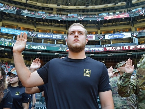 A future soldier from the Phoenix Recruiting Battalion recites the oath of enlistment April 9, 2017, prior to a Major League Baseball game between the Arizona Diamondbacks and Cleveland Indians. (Alun Thomas/Army)