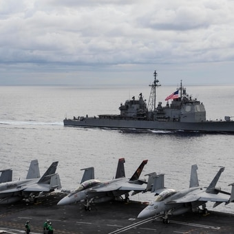 The Navy's cruisers run point on air defense of the aircraft carriers. Many analysts worry that losing the Navy's biggest surface combatants will put an unnecessary strain on the remaining ships. (MC3 Anthony Hilkowski/U.S. Navy)
