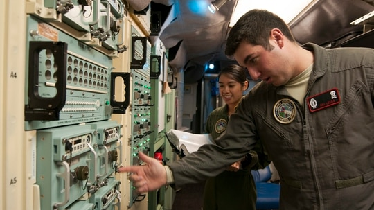 Air Force 1st Lt. Allia Martinez, 320th Missile Squadron missile combat crew commander, and 2nd Lt. Benjamin Lenos, 320th MS deputy combat crew commander, perform checks on the Strategic Automated Command and Control System in a launch control center at F.E. Warren Air Force Base, Wyo., in November 2016. (Staff Sgt. Christopher Ruano/U.S. Air Force)