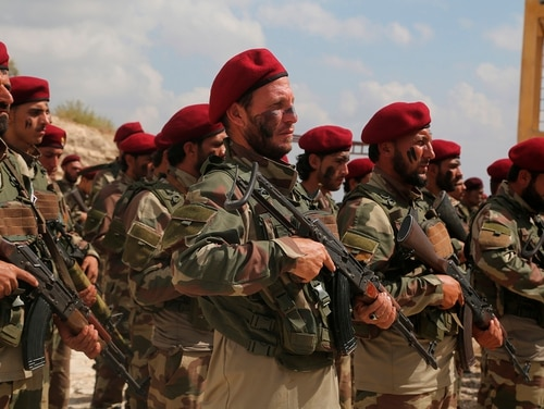 Turkish-backed forces from the Free Syrian Army stand in formation Oct. 7, 2019, during military maneuvers in preparation for a Turkish incursion targeting Syrian Kurdish fighters, near Azaz town, north Syria. (AP)