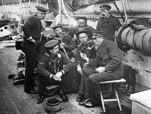 In this circa 1890 photo, seven sailors sit together on board the barque-rigged screw sloop Enterprise in New York. Though the Navy said in July 2018 that its servicewomen could wear longer hairstyles, beards have been barred for servicemen since 1984. (Naval History and Heritage Command via AP)