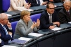 Armed drones for Germany? Merkel's would-be government sizes up defense priorities