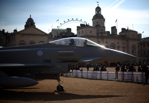 LONDON, ENGLAND - APRIL 01: Members of the public view a full-scale replica of a Eurofighter Typhoon as it is displayed at Horse Guards Parade on April 01, 2016 in London, England. The RAF Museum will display aircraft from WW1 and WW2 as well as a replica of a modern day Eurofighter Typhoon, to mark the RAF centenary of the Royal Airforce which takes place in 2018. (Photo by Carl Court/Getty Images)