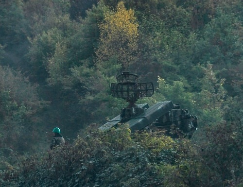 An Armenian soldier stands next to an air defense vehicle during fighting between Armenia and Azerbaijan over a disputed region on Oct. 15, 2020. Armed drones gave Azerbaijan a decisive advantage in the conflict. (Aris Messinis/AFP via Getty Images)