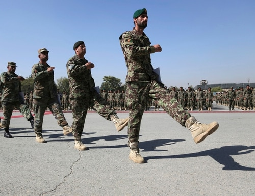 Newly graduated Afghan National Army march during their graduation ceremony after a three-month training program at the Afghan Military Academy in Kabul, Afghanistan, on Oct. 13, 2019. (Rahmat Gul/AP)