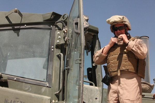 Brig. Gen. Glenn M. Walters, the 2nd Marine Aircraft Wing (Forward) commanding general, prepares to drive a bulldozer on Camp Bastion, Afghanistan, April 1. Walters and Sgt. Maj. Henry A. Prutch, the 2nd MAW (Fwd.) sergeant major, visited with MWSS-272 Marines preparing living spaces for 2nd MAW (Fwd.) Marines at Camp Bastion's hangars.