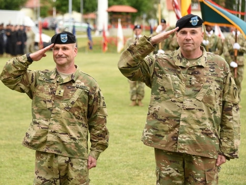U.S. Army Lt. Gen. Ben Hodges, right, the U.S. Army Europe commanding general, salutes alongside Maj. Gen. Christopher Cavoli during the 7th Army Training Command change-of-command ceremony at Grafenwoehr, Germany, on July 15, 2016. (Markus Rauchenberger/U.S. Army)