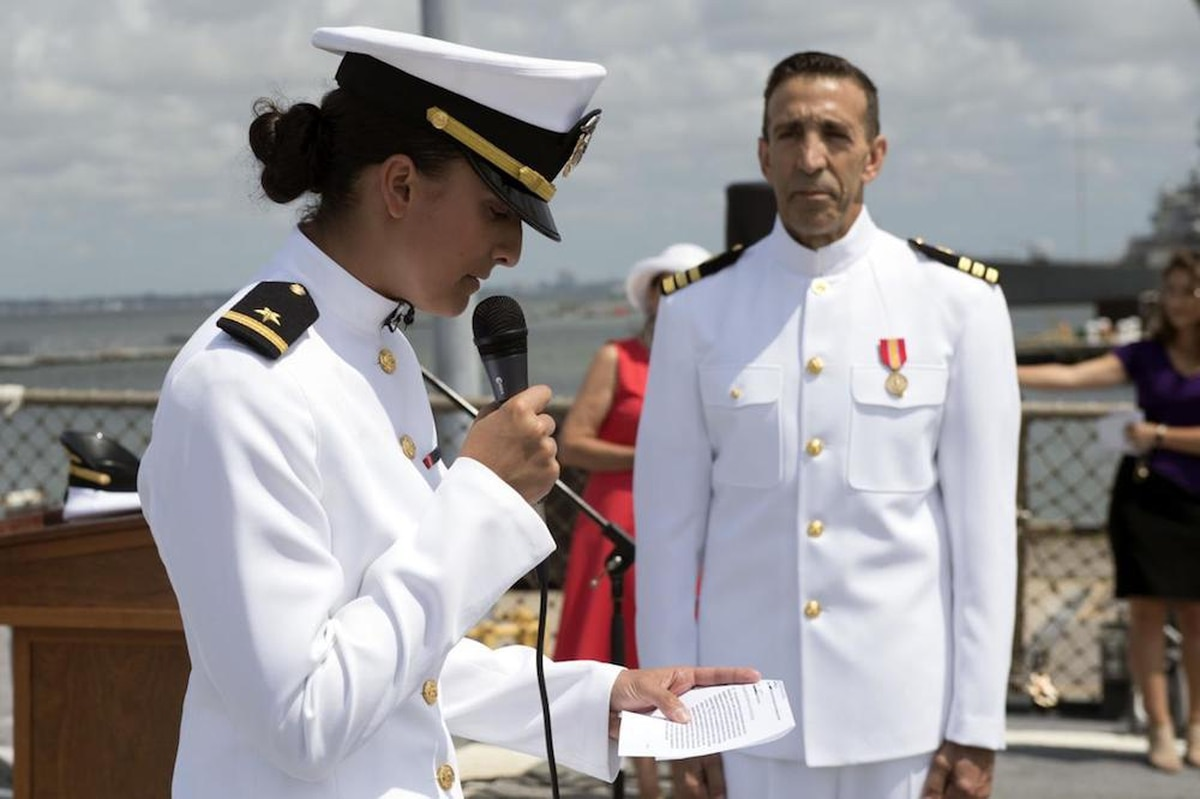 ensign commissions her 63 year old father as a navy officer