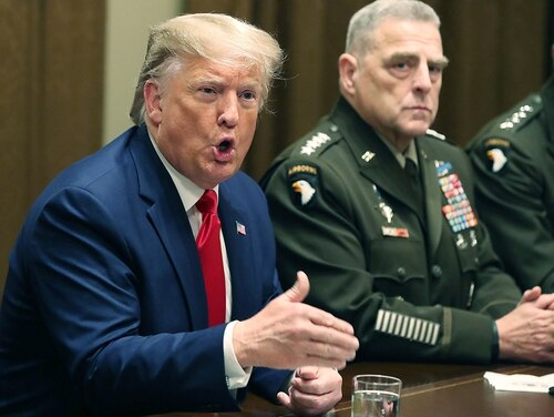 President Donald Trump speaks as Army Gen. Mark Milley, chairman of the Joint Chiefs of Staff, looks on after a briefing from senior military leaders in the Cabinet Room at the White House on Oct. 7, 2019, in Washington. (Mark Wilson/Getty Images)